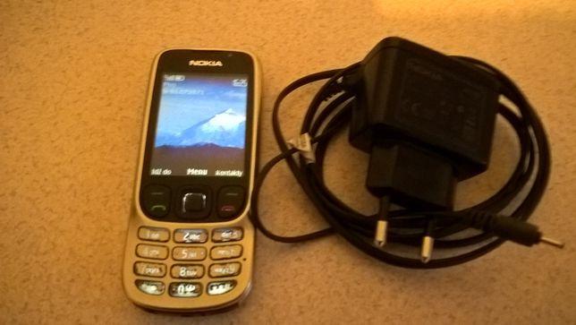 Telefon komorkowy, ladowarka, i akumulator caly komplet to NOKIA