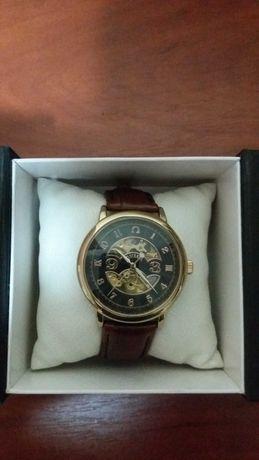 Часы Omega и AMST