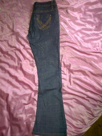 Spodnie jeansy wyszczuplające granatowe długie