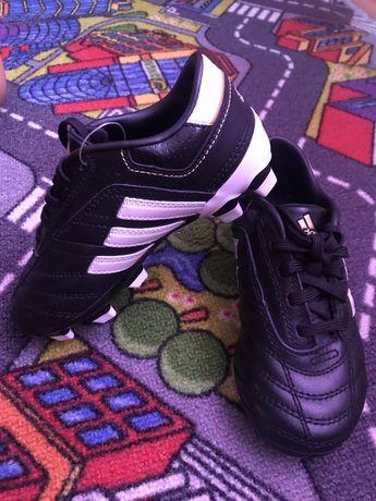 Бутси( футбольне взуття)