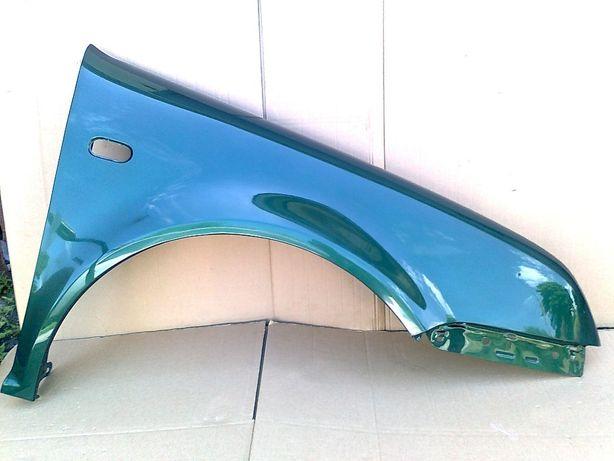 VW Bora prawy błotnik zielony met. LC6M