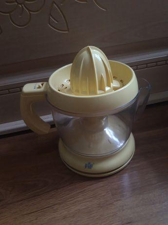 Електрическая соковыжималка для цитрусовых