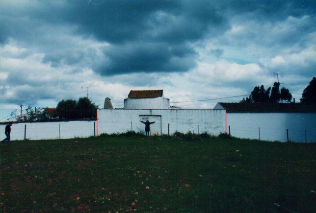 Casa com moinho e patio