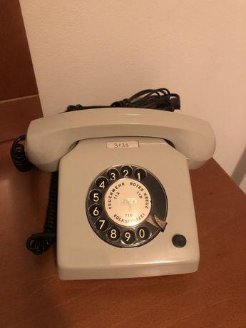 Telefone amtigo em bom estado