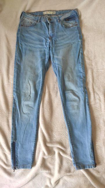 Jeansy z zamkami