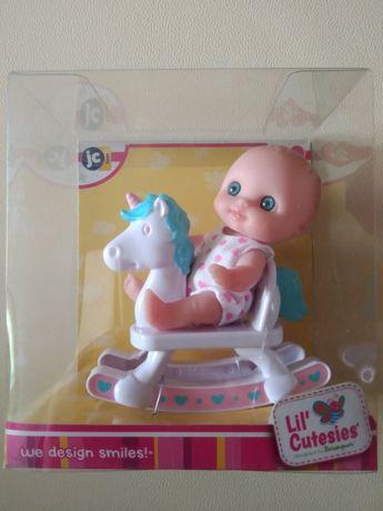Продам Пупс - малыш JC Toys на качалке (13 см), новый, в упаковке