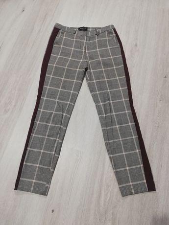 Spodnie w kratę Mohito