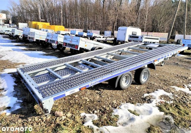 Lorries LAWETA DWUOSIOWA GRAWITACYJNA 2700DMC 4,5x2m LORRIES NAJAZDY  Nowa Laweta z najazdami aluminiowymi do przewozu pojazdów 4x2m DMC2700