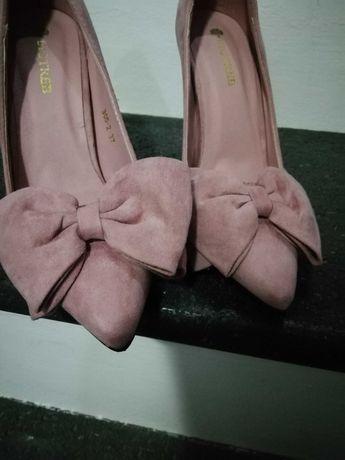 Sapatos rosa velho