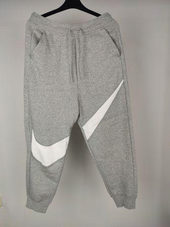 Damskie spodnie dresowe Nike L