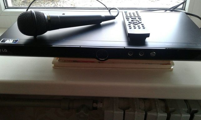 DVD проигрыватель LG с микрофоном  N DVX491К  200-240V- 50-60Hz10W.