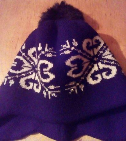 Продам зимову шапочку на девочку