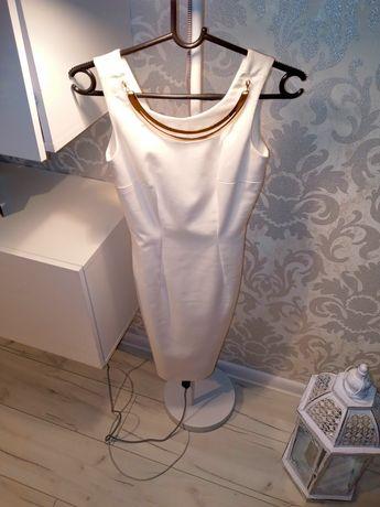 Biała sukienka ze złotą aplikacją