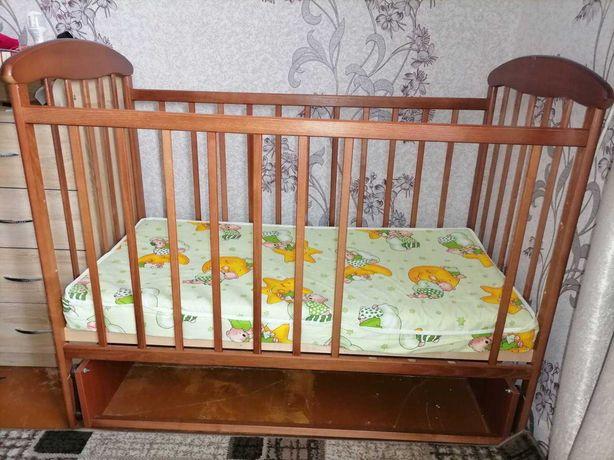 Кроватка дитяча люлька з маятником