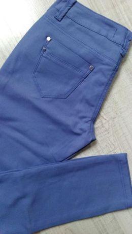 Spodnie jeansy rurki w kolorze niebieskim r. 26-32