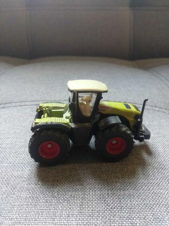 Трактор  іграшка siku claas 5000 xerion с цистерною 1:16