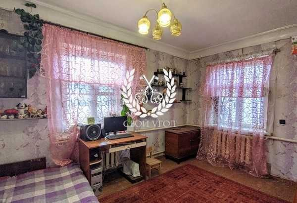 Продам часть дома в Чернигове с удобствами.