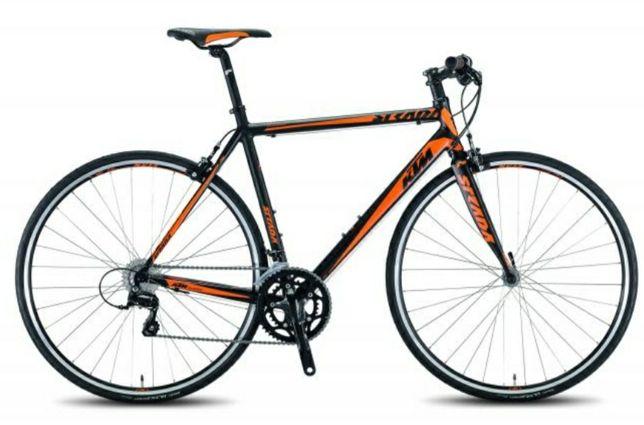 Bicicleta KTM  e sapatos