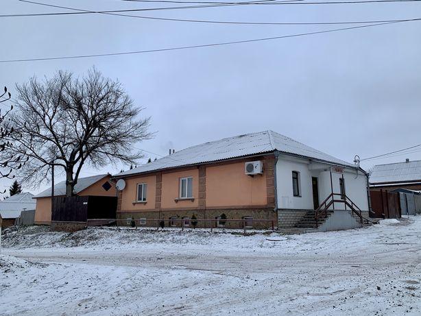 Жилой дом с магазином в Белополье