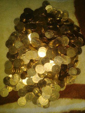Монети одна гривна металеві.