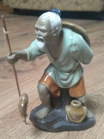Figurka porcelanowa rybaka