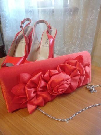 Праздничная сумка клатч оранжевого цвета
