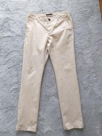 Eleganckie spodnie beżowe marki Zara rozm M