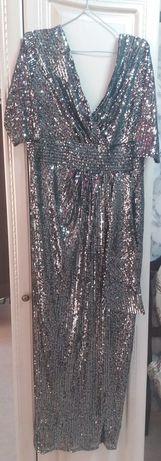 Сукня святкова ,нарядна в ідеальному стані.Платя на 48-50 розмір.