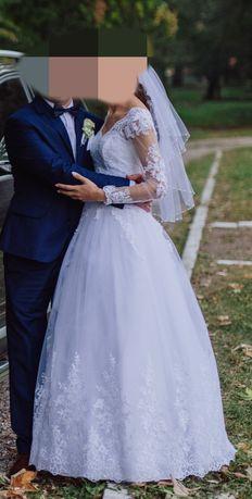 Przepiękna suknia ślubna z długim rękawem