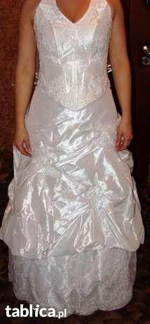 Sprzedam białą suknię ślubną z aplikacjami z koronki-używaną