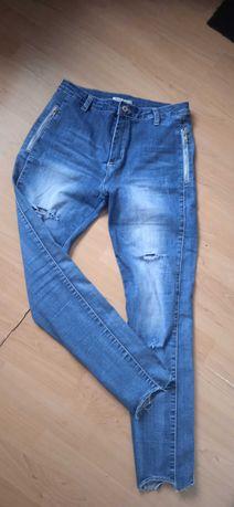 Spodnie z dziurami