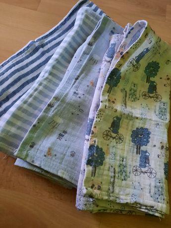 Zestaw nowych bawełnianych pieluszek dla chłopca.
