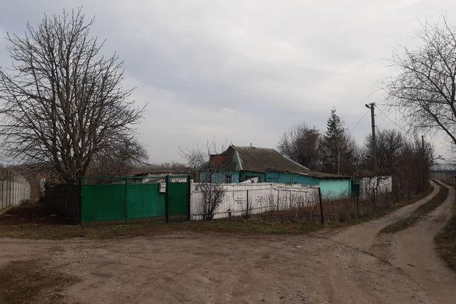 Продам земельну ділянку разом з будинком