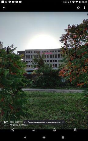 Промышленно-торговое недостроенное здание