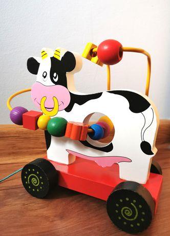 Drewniana krówka, zabawka edukacyjna do ciągnięcia
