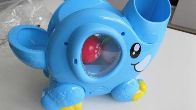 Grająca zabawka słonik z piłkami