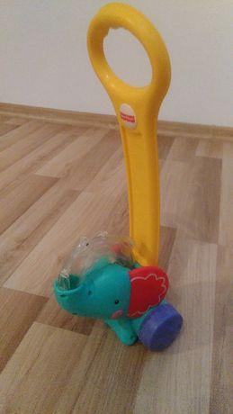 Piłeczkowy słonik, pchacz Fisher Price, zabawka.