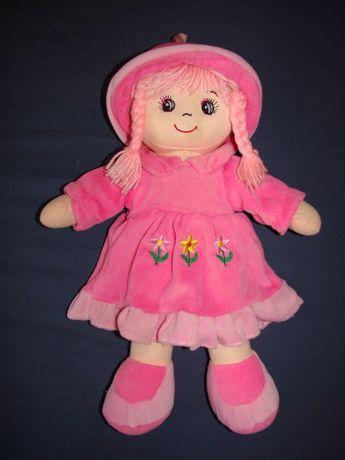 Lalka w różowym ubranku