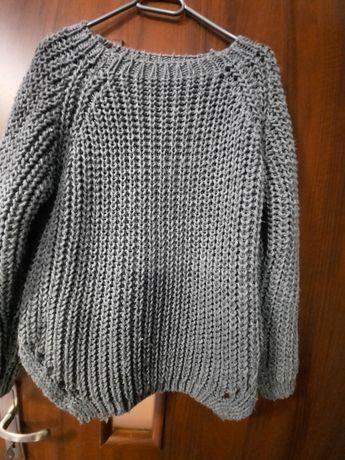Swetry wełniane damskie
