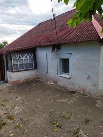 Продам дом на центральной улице,Магдалиновка