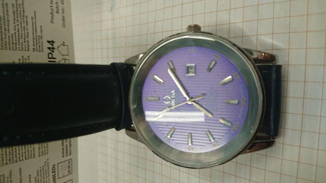150zl duzy elegancki zegarek na baterie logowany znakiem Omega