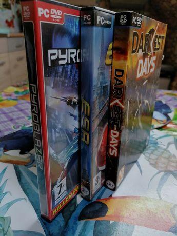 Trzy gry komputerowe PC.