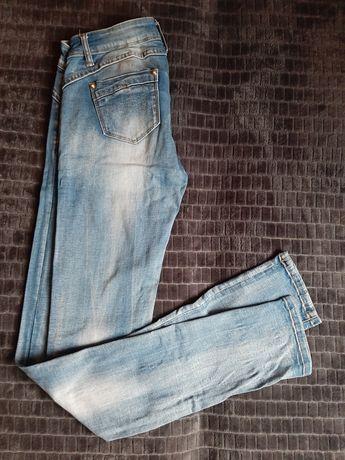 Spodnie damskie rurki jeansowe z przetarciami rozm S/36