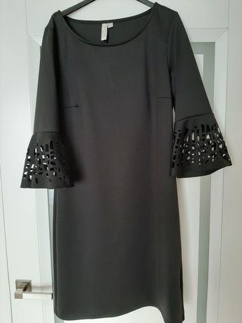 Sukienka wizytowa efektowne rękawy
