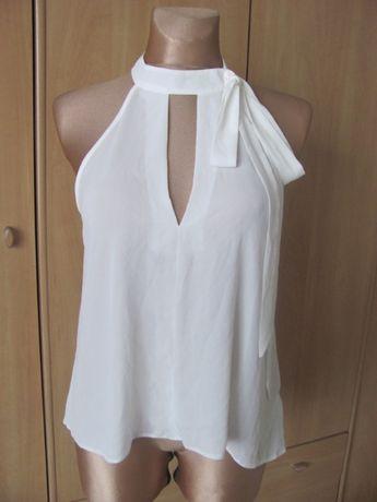 Bluzeczka biel z kokardą rozm.40-42