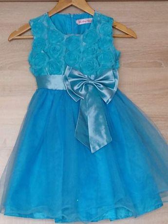 Sukienka na wzrost 140.