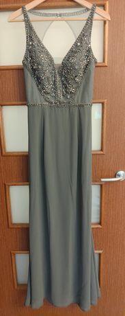 Długa suknia z dekoracyjną gòrą bez plecòw na ramiączkach