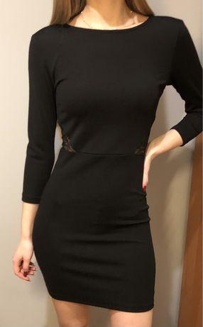 Obcisła czarna sukienka