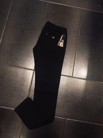 Czarne jeansy Elegant's rozmiar L 40 nowe z metką
