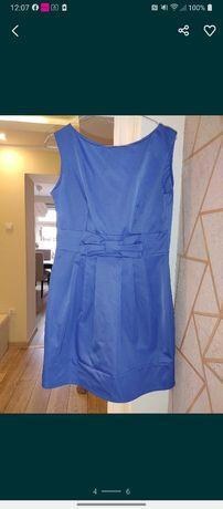 Niebieska sukienka z kokarda